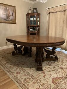 RJ Horner Quarter Sawn Oak Dining Table With Winged Griffins and 6 chairs.