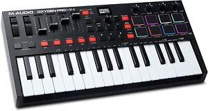 M-Audio Oxygen Pro Mini – 32 Key USB Keyboard Controller w/Beat Pads & Software!