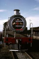 PHOTO  SOUTH AFRICAN RAILWAYS A 19D CLASS 4-8-2 ON SHED AT GRAAFF REINET