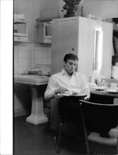 Rudolf Khametovich Nureyev eating. - 8x10 photo