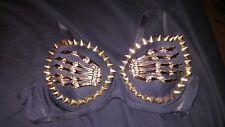 golden spikes and skeleton hands black bra