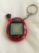 Tamagotchi Connection Red with Butterflies and Star 2004