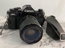 Canon A-1 SLR FILM CAMERA - MITAKON 1:3.3/4.5 34-70 mm Lens. Plus Case & Flash.