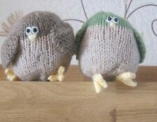 TWO HAND KNITTED BIRD SHELF SITTERS. DISPLAY, NATURE, SUN ROOM.