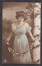 Postcard of a glamerous young lady. Stamp/postmark 1912