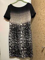 St. John Sheath Silk  100% Lined Zip Back Round Neck animal print dress Sz 8