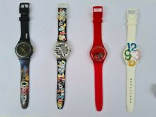 Four Swatch watches for sale