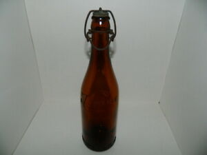 """HABERLE BEER BOTTLE WITH STOPPER – 9-7/8"""" TALL – EMBOSSED BROWN BOTTLE"""