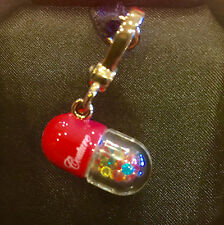 NWT 2011 JUICY COUTURE PILL CHARM (RETIRED) YJRU5394