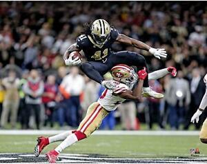 "Alvin Kamraa New Orleans Saints Unsigned Hurdling Defender 11"" x 14"" Photo"