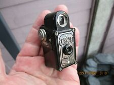 A Vintage Black Bakelite Coronet Midget Camera With Film Inside