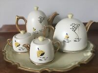 Vintage Heatmaster teapot, coffee pot, milk & sugar with retro covers and tray