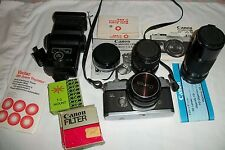 Canon ftb camera, micro & telephoto lenses, Vivitar flash, filters & Carry Case