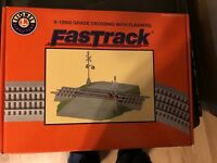 Lionel # 6-12052 FASTRACK Grade Crossing w/ Flashers - NEW IN ORIGINAL PACKAGING