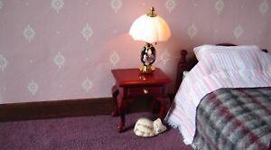white starburst on pink dolls house wallpaper