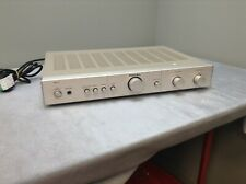 Rotel RA01 amplifier with built in phono, silver 220 watts.