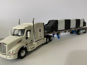 wsi peterbilt 579 truck w/sword East flatbed trailer w/load 1,50