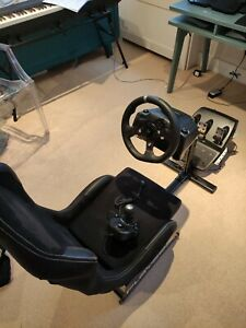 Logitech G920 Steering Wheel and Shifter. Does not come with seat. Xbox and PC.