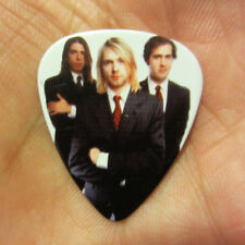 Nirvana Collectors Guitar Pick; Well Dressed Trio; Kurt in Pin Stripe Suit