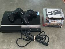 Sony PlayStation 3 40GB Conosle - Piano Black Two Controllers And 8 Games