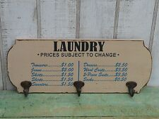 Primitive country style wooden laundry sign with rusty metal hooks wall decor