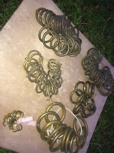 collection of antique brass curtain rings