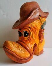 Vtg orange Cowboy boot with face spurs piggy bank Hens & Kelly sticker Japan