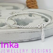Inka 925 Sterling Silver stretch beaded Stacking Bracelet with a Feather charm