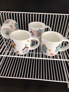 Set of 4 bulbous bone china mugs assorted  beach huts designs