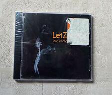 """CD AUDIO MUSIQUE / LET ZE LÉO """"JOUE ET CHANTE LÉO FERRÉ"""" 2010 NEUF CD ALBUM 15T"""