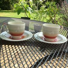 PAIR OF BANDED SUSIE COOPER COFFEE CUPS AND SAUCERS