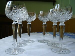 6 X Good quality cut crystal hock/wine glasses. Star cut bases.