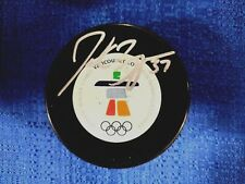 2010 VANCOUVER OLYMPICS GOLD MEDAL WINNER PATRICE BERGERON AUTOGRAPHED GAME PUCK