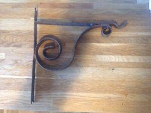 A Vintage Hanging Basket Bracket Wrought Iron blacksmith made