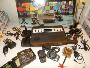 Vintage Atari 2600 1977 Game Console w/7 Games 4/Joy Stick 2/Paddles 1/Switch Bo