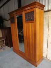 Edwardian satin walnut wardrobe. Good condition. Comes apart for easier moving.
