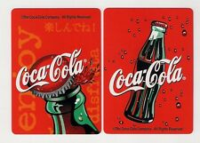 2 single poker playing cards, collect/swap jokers, Coca-Cola bottles, coke, red