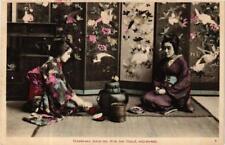 PC O-Koto-san takes tea with her friend O-Hana-san JAPAN (a5417)