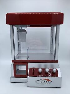 The Claw Electronic Candy or Toy Grabber Crane Machine Mini Arcade Game w/ sound