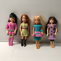 MATTEL TINY DOLL WITH CLOTHES THAT ARE MADE RUBBER 4 dolls 3 1/2