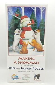 SunsOuts Makeing A Snowman by Tom Wood 300 Piece Jigsaw Puzzle 18x24 New