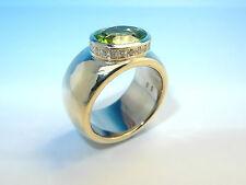 Unbehandelte ovale Ringe mit Edelsteinen aus Gelbgold