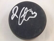 Logan Couture Signed In Glas Co Official NHL Game Puck w/ #39 In Silver Sharpie