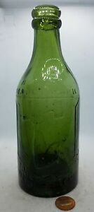 PRATT MANCHESTER ARM AND HAMMER PICTORIAL GREEN GLASS BEER BOTTLE