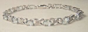 STERLING SILVER AQUAMARINE XOXOXO BRACELET WITH DIAMOND ACCENTS SIZE 7.25