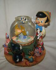 "Disney Pinocchio Musical Water/Glitter Snow Globe Plays ""TOYLAND"" Moving Cleo"