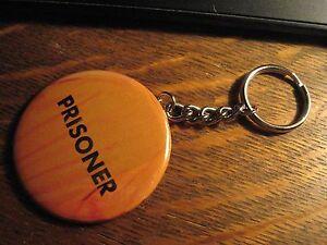 Prisoner Keychain - RePurposed Magazine Orange Jumpsuit Ad Backpack Ornament