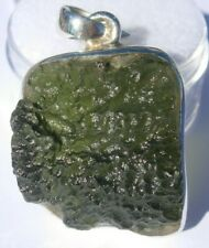 About 11.51 carats Moldavite Pendant 27x20x10mm set in solid .925 silver