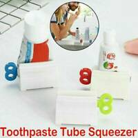 Easy Squeezer Toothpaste Roller Tube Rack Dispenser Rolling Holder Suction Tool