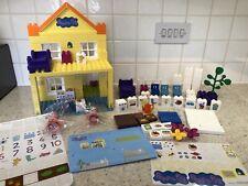 Peppa Pig Toy-Deluxe Casa con Construction Mummy & Peppa Plus un montón de extras